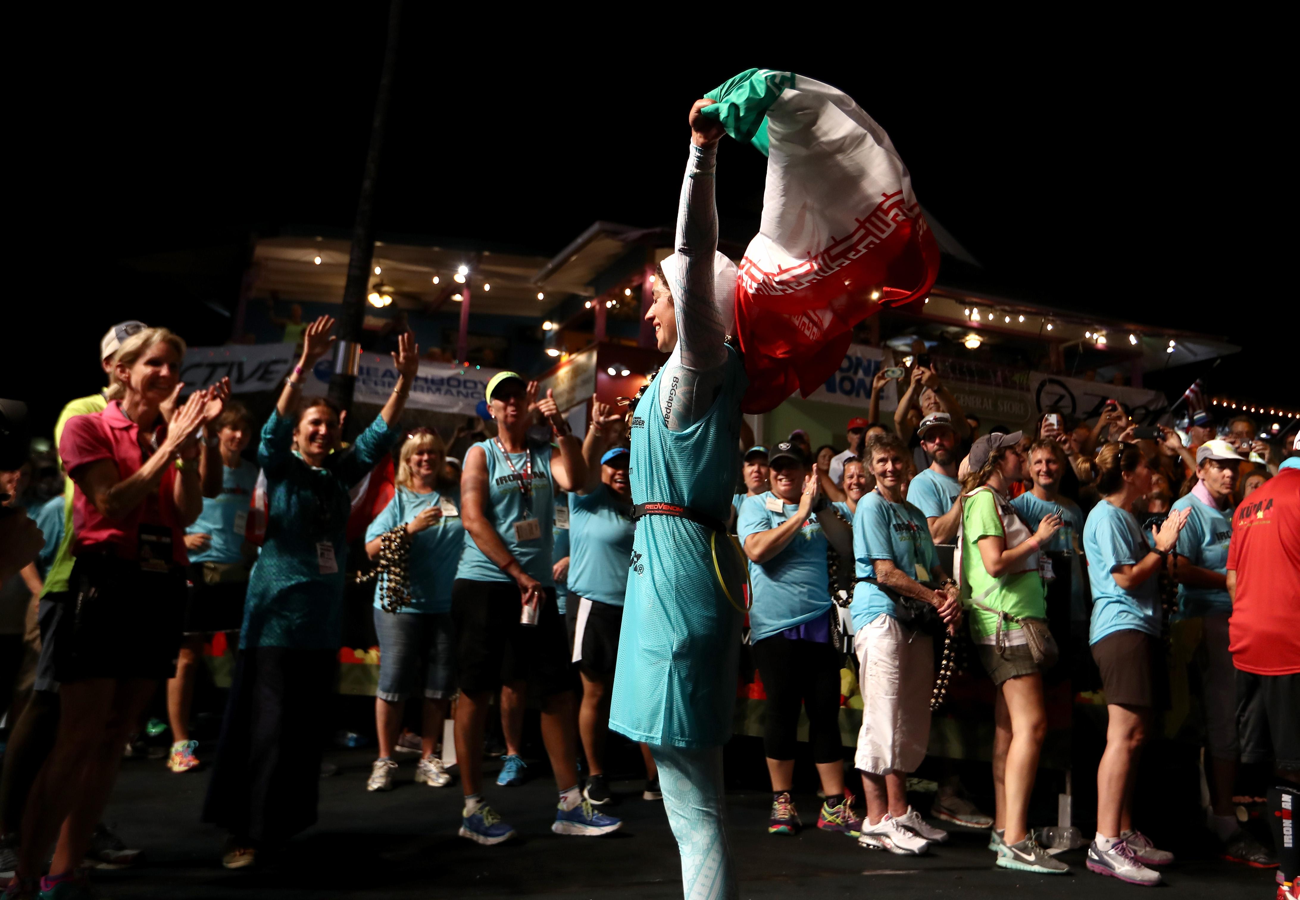 KAILUA KONA, HI - OCTOBER 08: Shirin Girami #151 of Iran reacts after crossing the finish line in the 2016 IRONMAN World Championship triathlon on October 8, 2016 in Kailua Kona, Hawaii. (Photo by Sean M. Haffey/Getty Images for Ironman)